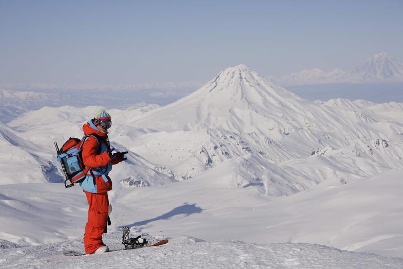 Alexander Moroz on the top of the Mutnovsky volcano, in the background Vilyuchinsky volcano. Photo by Maxim Balakhovsky.JPG