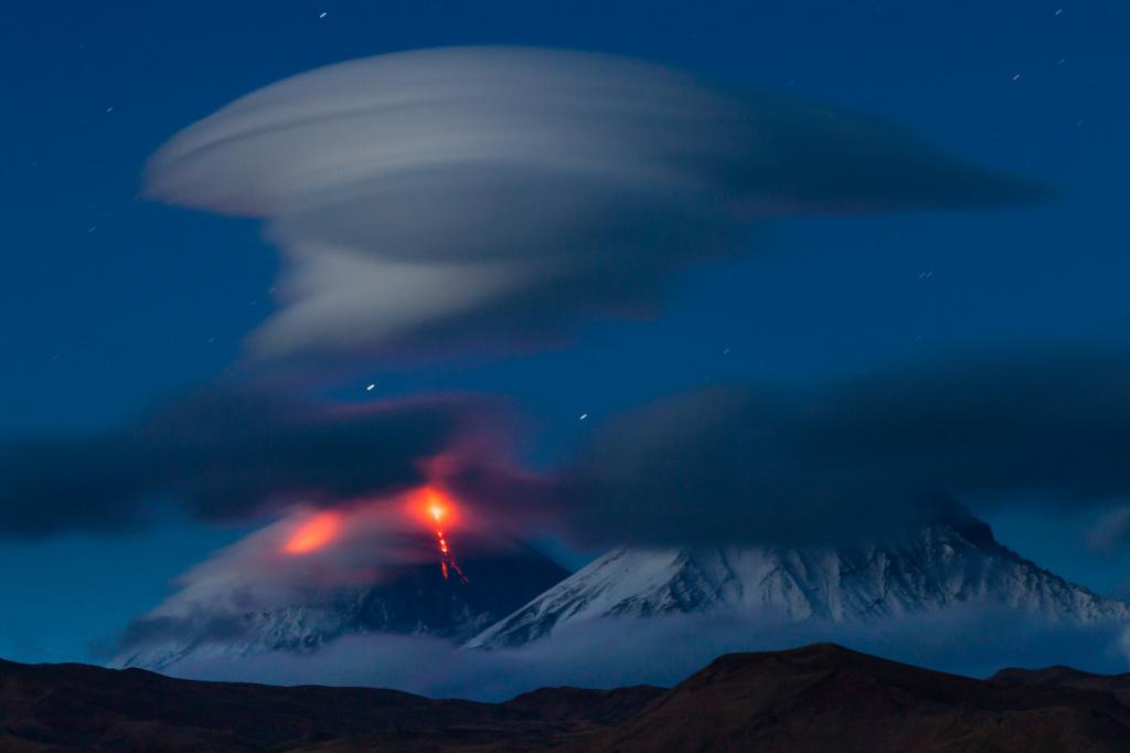 Photo by Denis Budkov. The eruption of Klyuchevskoy volcano and an amazing lenticular cloud above its peak. 2010 g.jpg